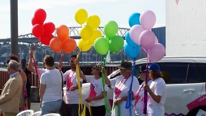 P2P volunteers release the rainbow balloons.
