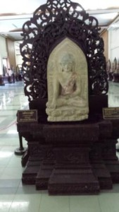 Buddha on teak seat