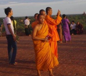 Monks photograph the sunset