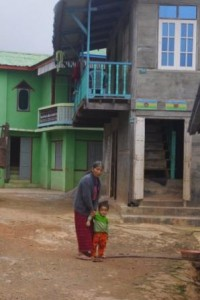 A grand new house. Elderly woman with grandchild