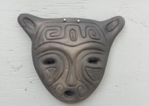 Black ceramic mask on the shed